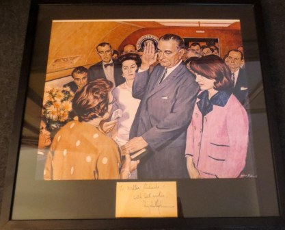 "We were antiquing on Cape Cod and came across this lithograph of the iconic swearing in photo. LBJ autographed it with his best wishes to the artist. My friend Dale said he was surprised he hadn't inscribed it ""on the happiest day of my life."""