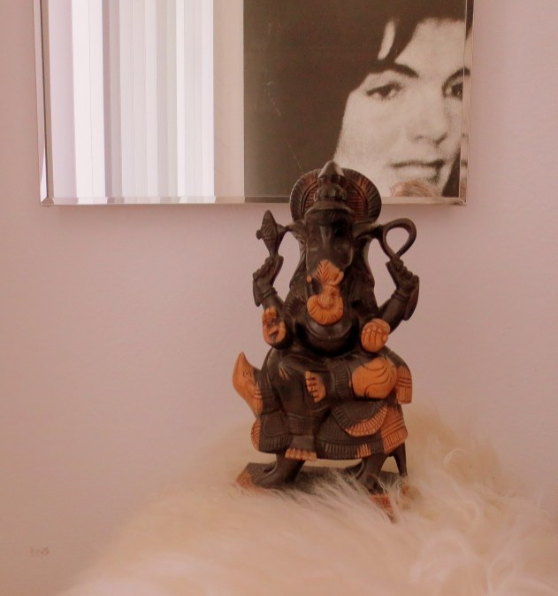 Opposite Jackie in the stool area is the Hindu God Ganesh. He is the remover of all obstacles.