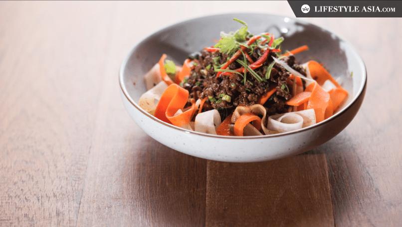 wagyu beef zhajiangmian, iberico chorizo, oyster sauce, carrots, bean sprouts and onion