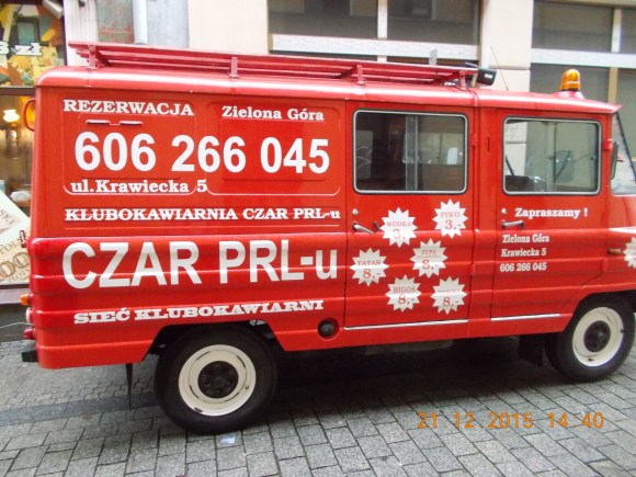 Car painted red with the restaurant's name Czar PRL-u