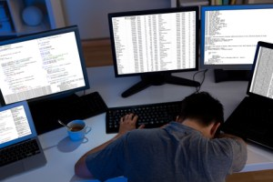 Computer programmer sleeping in the office