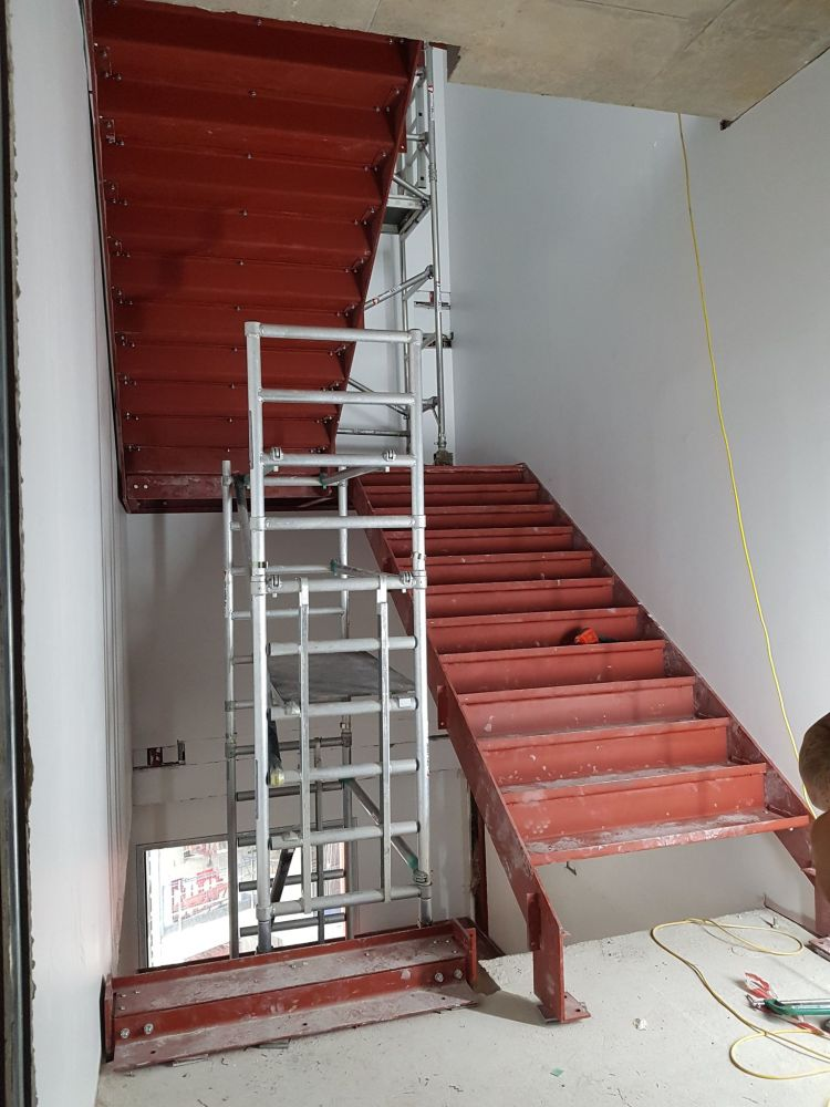 internal fire escape stairs with scaffold at WeWork, East Road