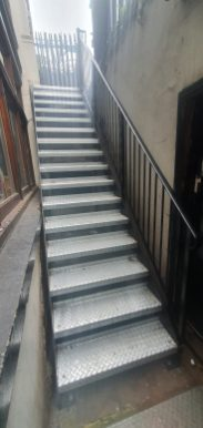 steel basement access staircase by LSJ Engineering, at Old Burlington St, Mayfair, London