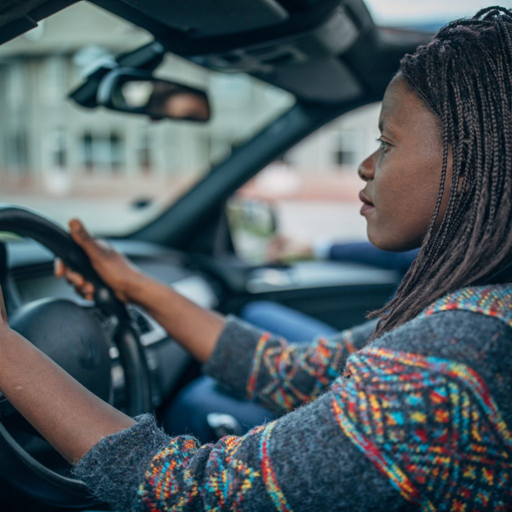 Image of woman driving in her car, looking concerned and wrapped up in her thoughts much like I was wrapped up in anxiety driving to the doctor's office.
