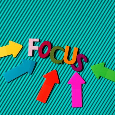 Image of teal background with the letters F-O-C-U-S spelled out in multicolor.
