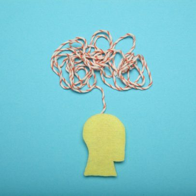 Image of a cut-out yellow head with a tangled mess of string above it, representing the confusion and anxiety Jaclyn felt when she was diagnosed with Lichen Sclerosus.