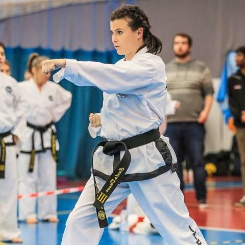 Female Martial Arts blackbelt punching