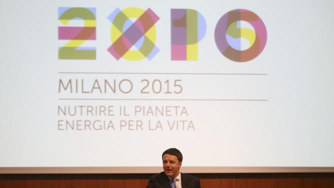 Italian Prime Minister Matteo Renzi delivers his speech during his visit in Milan, Italy, Tuesday, May 13, 2014. Renzi later visited the Expo 2015 construction site, where more than 132 countries will be establishing their pavilions for the world's fair that will open on May 1, 2015 and continue until the end of October of that year. (AP Photo/Antonio Calanni)