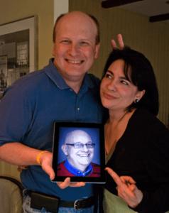 Howard Yermish, left, and Sandy Spadaro pose with Howard's iPad2 featuring Steve Lubetkin.