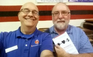"""Steve, left, with Mike O'Connell, host of the """"It's All Journalism"""" podcast, with a copy of <em>The Business of Podcasting: How to Take Your Podcasting Passion from the Personal to the Professional,</em> purchased at the Podcast Mid-Atlantic Conference."""