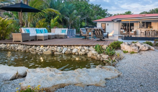 Natural Florida Limestone Pond and Custom Pool in Osprey, Florida