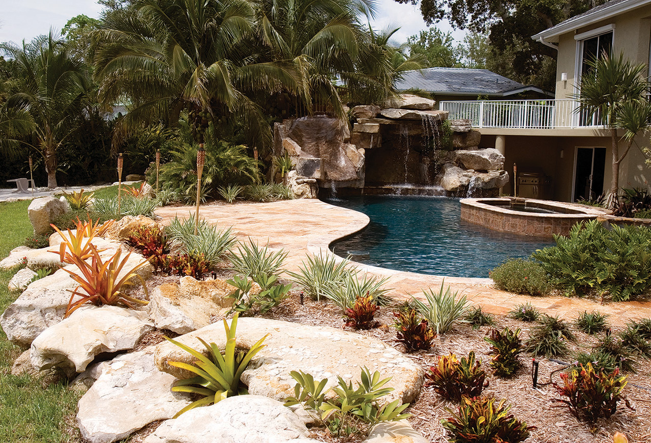 custom swimming pool with natural stone waterfalls and pool grotto pool after - Swimming Pools With Waterfalls And Slide