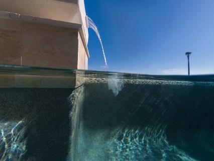 Bradenton custom pool builder insane pools fire pit