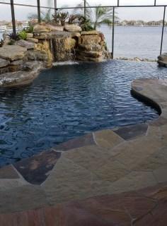 Flagstone deck, waterfall and infinity edge