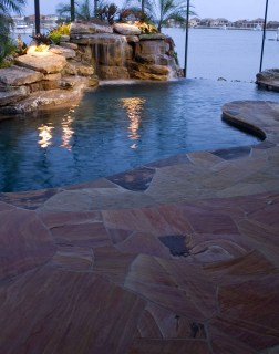 Flagstone deck, waterfall grotto and infinity edge