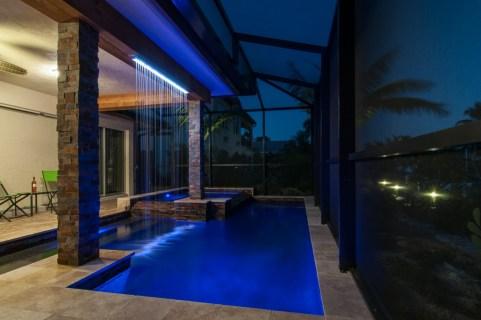 Rain curtain and modern swimming pool