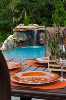 Looking over an outdoor dining area to a new lagoon pool waterfall