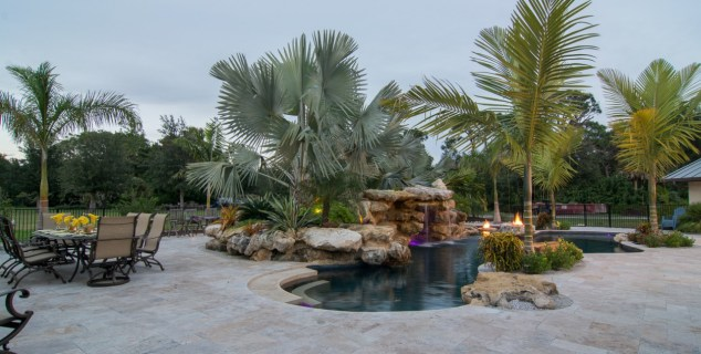 Lagoon Pools Outdoor Living Design shallow swim up bar pool rock waterfalls