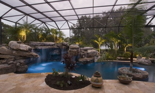 Travertine deck surrounding lagoon pool