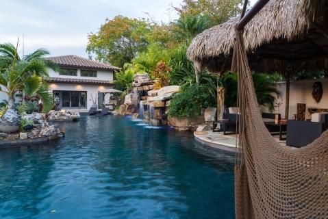 natural-rock-waterfall-pool-siesta-key-donzi-tiki-hut-hammock