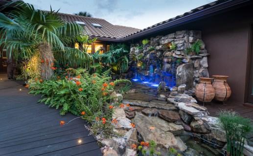 natural-rock-waterfall-pool-siesta-key-wood-bridge-water-wall
