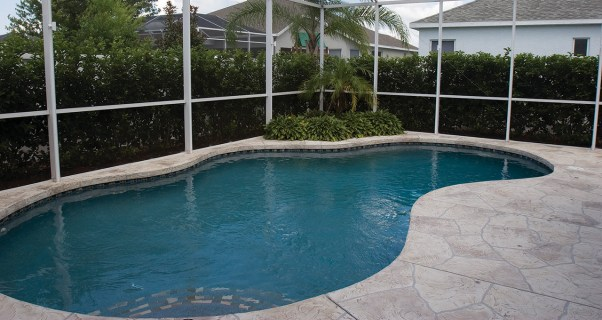 lucas lagoons pool remodel with wooden bridge before