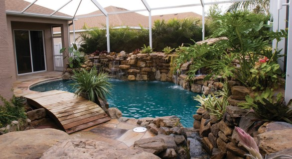 lucas lagoons pool remodel with wooden bridge stream view lagoon-pool