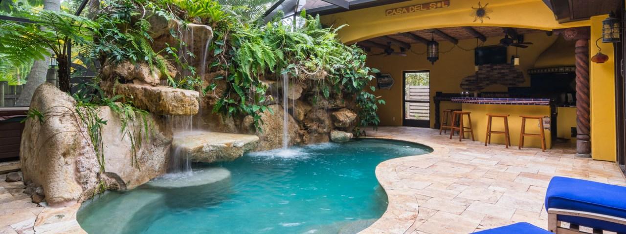 Designer Series Semi-Custom Pools siesta key caribbean limestone outdoor living kitchen sarasota pool
