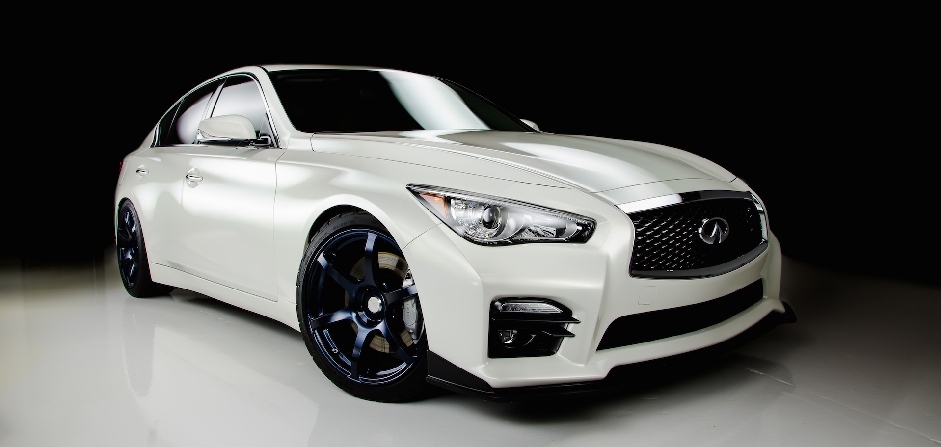 car bra paint protection film on white infiniti