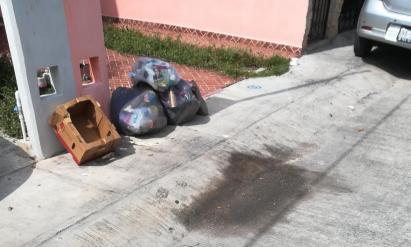 Basura en calles de cancún esqu