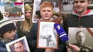 boy holding portrait of veteran
