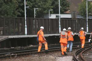 Four railworkers on the track