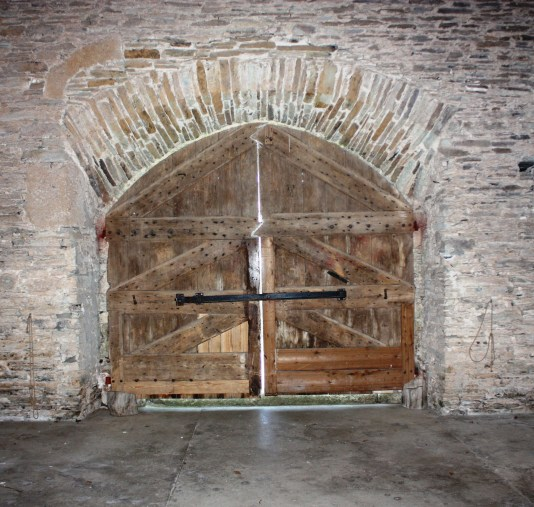 Huge doors were built to allow carts to drive in at one and out at another so that goods and produce could be unloaded in shelter.