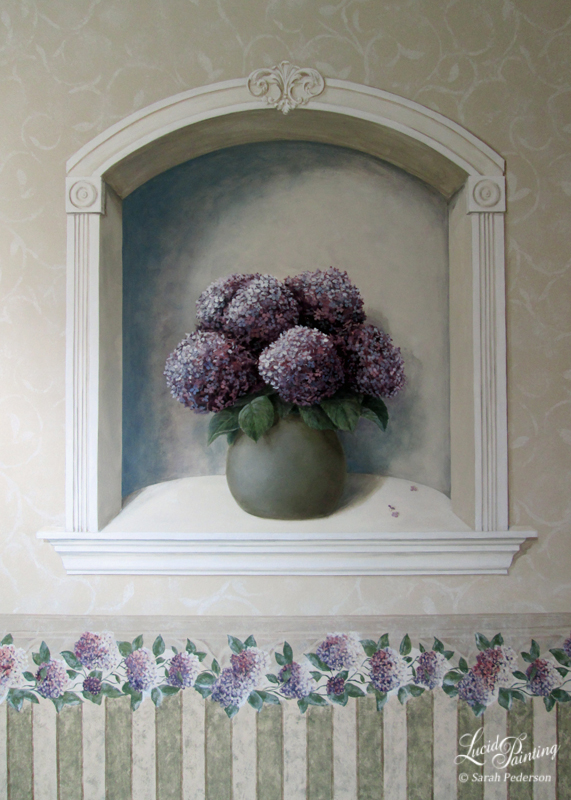 Striped wainscot, repeating hydrangea pattern in the chair rail, and swirls with leaves were all recreated using decorative painting techniques and carefully matching colors used in the actual wallpaper on other walls. This large niche adds a focal point to the room and is very pleasing to the eye.