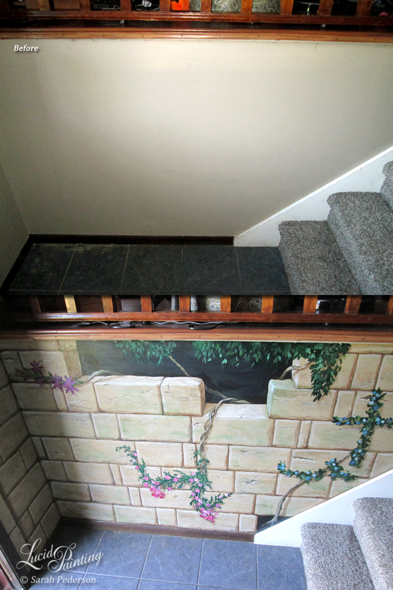 I painted this wall to look like stones that are all six inches tall with varying widths. Vines with a variety of tropical flowers appear to be growing behind the wall and are coming into the home.