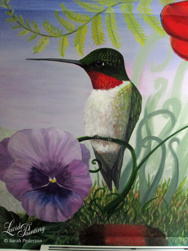 This three foot tall ruby throated hummingbird is sitting on a fantasy curly grass with more curly grasses fading away in the distance. A three foot long woolly bear caterpillar is along the baseboard and a large purple pansy is in the foreground. The end of the fern from the opposite wall curls onto this wall just above the hummingbird.