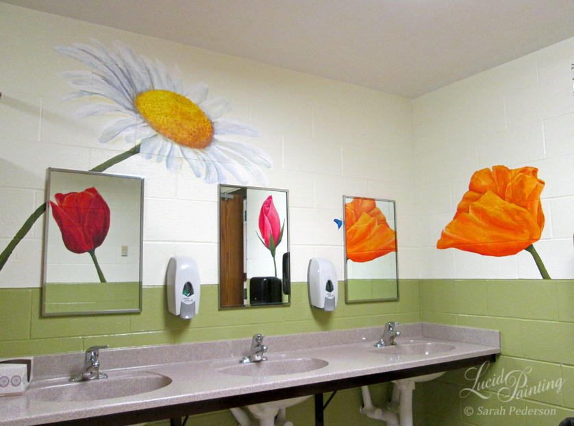 Large flowers painted in bathroom include daisy, tulip, rose, and poppy.