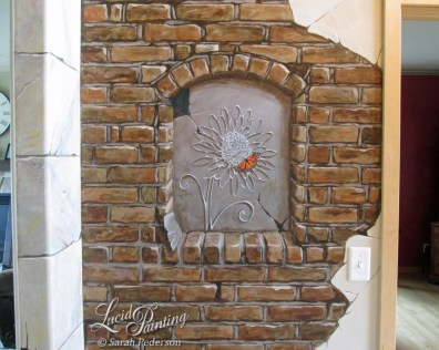 Brick niche exposed behind cracked plaster.