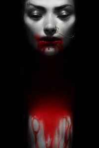 A pale woman is clothed in darkness, her naked chest covered in bright red blood.