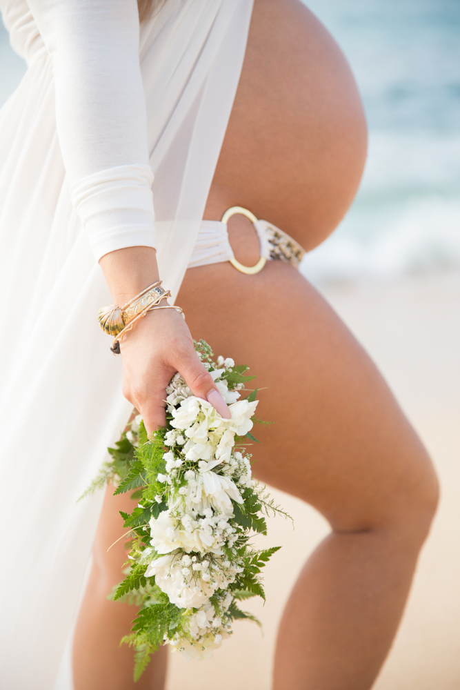 Maternity beach photo with flowers