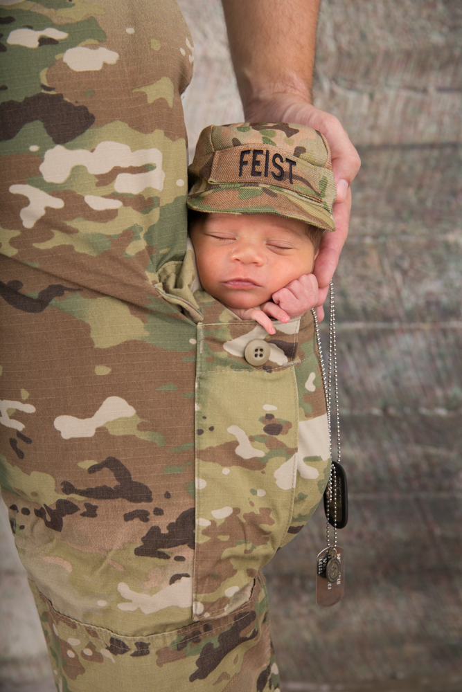 Newborn in military fatigue pocket