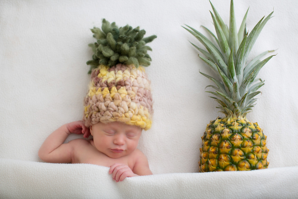 Newborn and pineapple