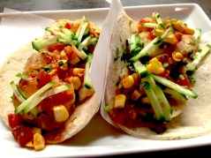 Fresh fish tacos with roasted corn and crisp cucumbers