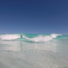 In shallower water with smaller waves you can wait until just after the break