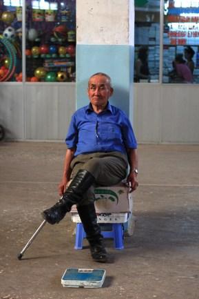 Man with scales, Naran Tuul 'Black' market, Ulaanbaatar