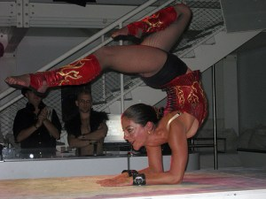 A contortionist poses while wearing a genuine Dark Garden corset.