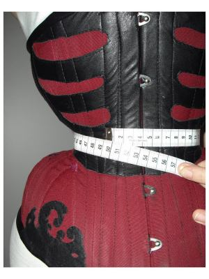 "Milla currently, measuring 49cm (19.3"") over her corset (about 46-47cm or 18-18.5"" underneath)."