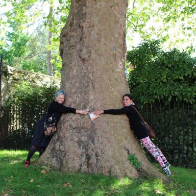 Hugging a tree somewhere near where Quidditch matches are held, with Joni of Rainbow Curve Corsetry