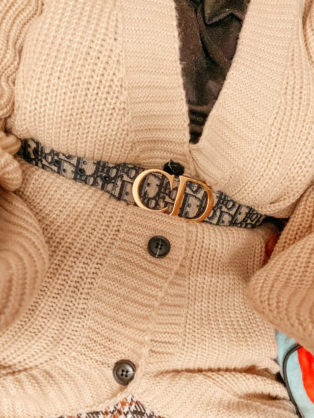 close up of the dior plus size belt with a cardigan