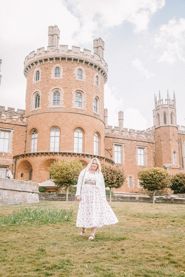 lucy stood in front of the castle
